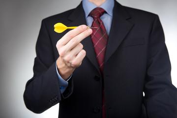 Businessman holding dart