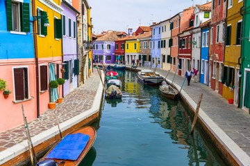 Burano canal full of boats and colorful houses