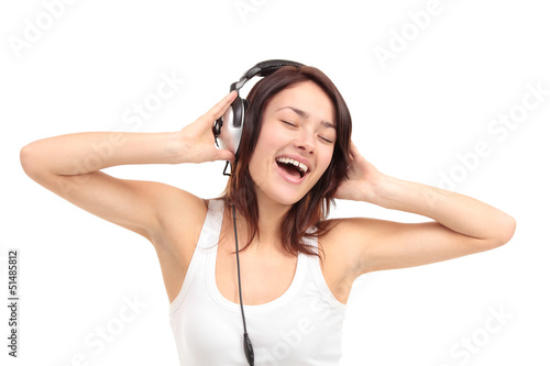 Woman with headphones listening music on player