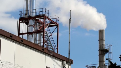 Smoking chimney of an industrial building