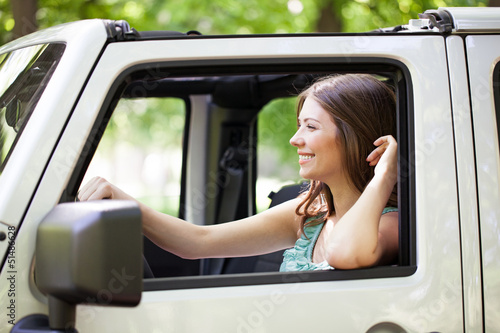 Young Woman Enjoying a Car Ride