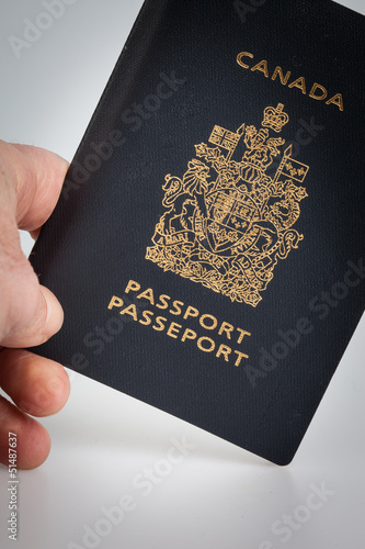 Hand holding a Canadian passport