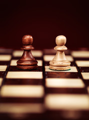 Two pawns on chessboard