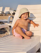 baby on  sun lounger