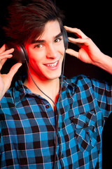 Young and handsome dj with headphones - Disco light effect