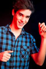 Young man dancing and enjoying music at disco