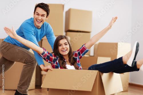 Couple having fun in new home .