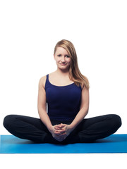 young woman yoga exercise the butterfly - isolated