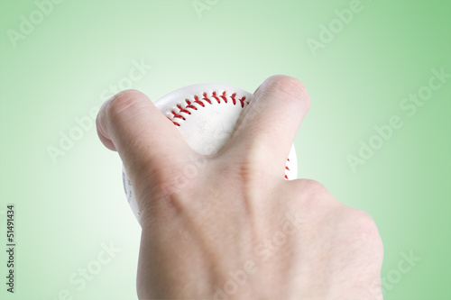 split finger baseball grip on green with clipping path