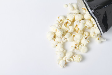 a bag of white cheddar popcorn spills out of a bag