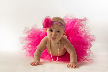 Pensive Baby Ballerina Pauses in Her Crawl