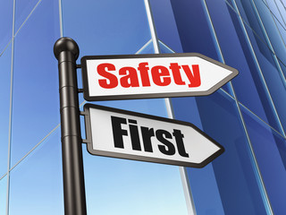 Protection concept: Safety First on Business Building background
