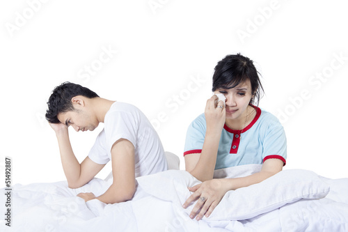 Sad couple after fighting in bed