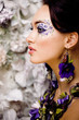 floral face art with anemone in jewelry, sensual young brunette