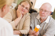 Doctor or Nurse Explaining Prescription Medicine to Senior Coupl
