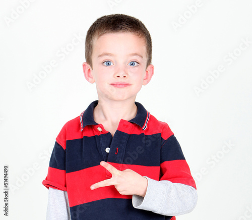 Young preschooler kneeling on white background