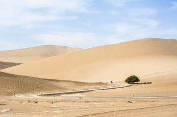 A winding path in the desert, Dunhuang, China
