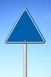 triangular road sign with sky