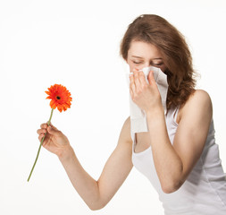 Woman having allergy from spring flowers