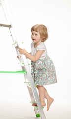 The naughty little girl walking down the stepladder