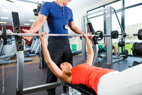 woman and Personal Trainer in gym