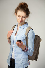 Woman with bag and mobile phone