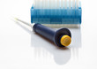 Laboratory pipet in front of disposable tips pack
