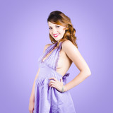 Attractive young pinup girl in retro purple dress