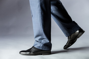 Feet of man in shoes