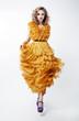 Shopping. Woman Blonde Fashion Model in Yellow Dress. Sales