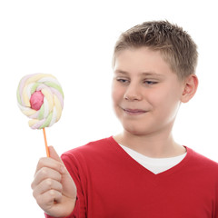 boy looking at lollipop