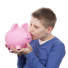 cute boy kissing pink piggybank