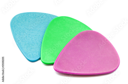 Colored guitar plectrum set isolated on white background.