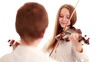 Two teenager playing the violin, studio shot