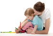 Young mother and her daughter drawing together; white background