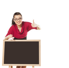 girl with glasses, standing behind an empty table to show someth