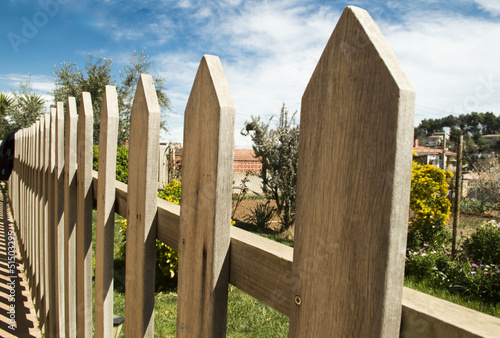 wooden fence and blue sky background