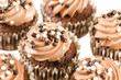 Chocolate cupcakes with chocolate icing and decoration isolated