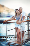 Couple in love on dating near sea at honeymoon