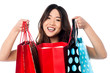 Pretty young chinese girl holding shopping bags