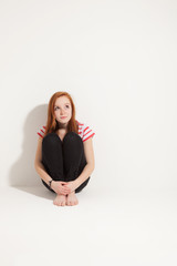 portrait of cute redheaded girl, isolated on white background