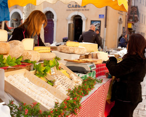 Sale of French cheese in a street market in Cassis