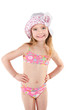 Cute smiling little girl in swimsuit and cap isolated