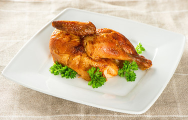 grilled chicken decorated with green parsley