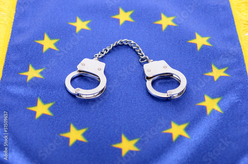 Flag of European Union and handcuffs