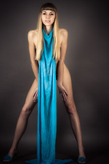 leggy nude woman standing in full length with a scarf