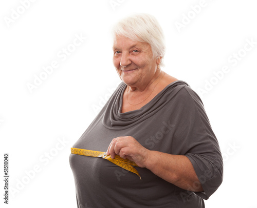 fat woman measuring breast