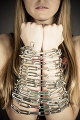beautiful woman with chained hands