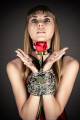 beautiful woman with a rose in hand