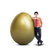 Businessman and gold egg - isolated